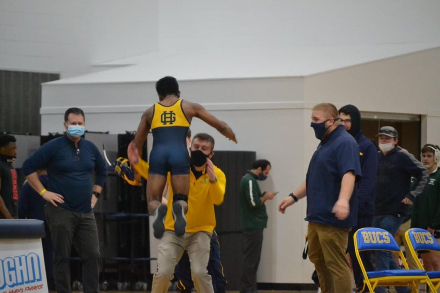 Hefzur Rahman jumping to his coaches arms after a victory