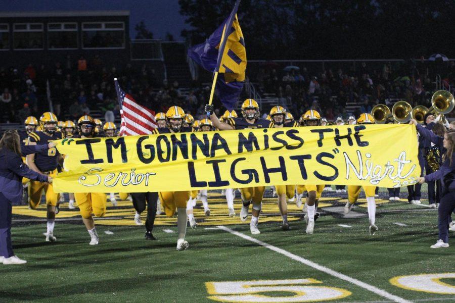 Football falls to Rockford on senior night