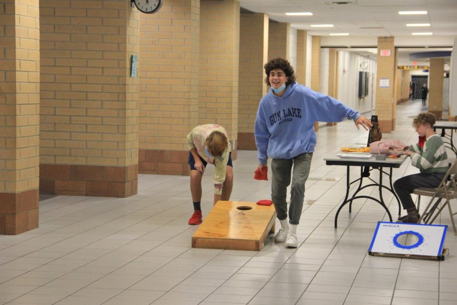 Students participate in a game of corn hole set up by the Buc Stop staff.