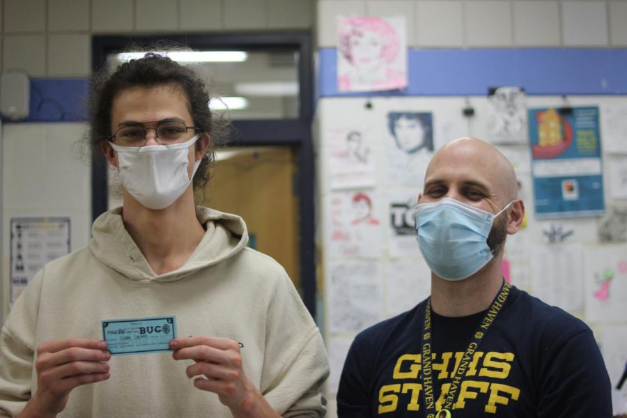 Junior Xander LaLonde was awarded a BUC$ during a art class by teacher Mitch Moore.